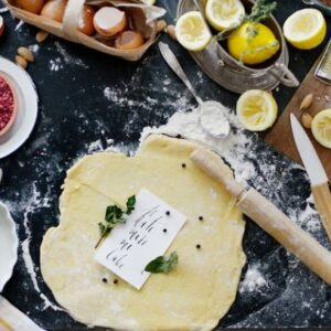 dough-and-flour-near-lemons-and-rolling-pin-1070880